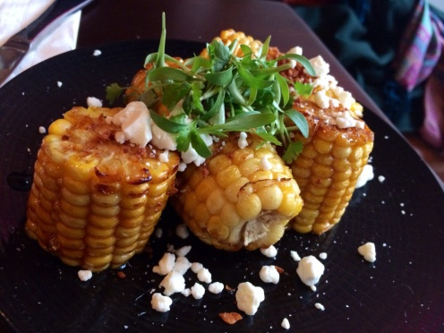 Corn on the cob with sweet BBQ glaze, soft goat cheese and cilantro